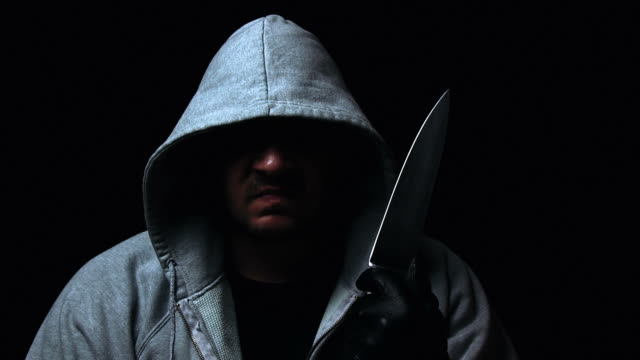hooded killer - knife weapon stock videos & royalty-free footage