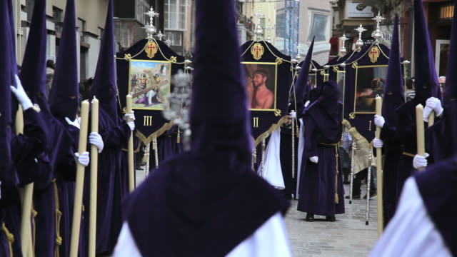 hooded nazarenos parade during the celebration of semana santa a holy week in malaga spain, europe - holy week stock videos & royalty-free footage