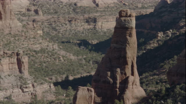 A hoodoo stands in a canyon. Available in HD.