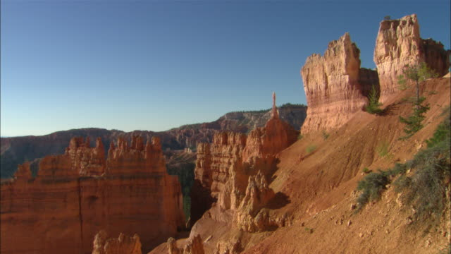 Hoodoos and blue sky Available in HD.