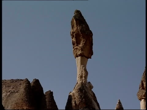 Hoodoos rise over other rock formations in Cappadocia.