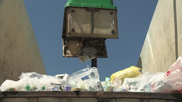 slo mo ms la hook dumpster emptying waste container, vrhnika, slovenia - vrhnika stock videos & royalty-free footage