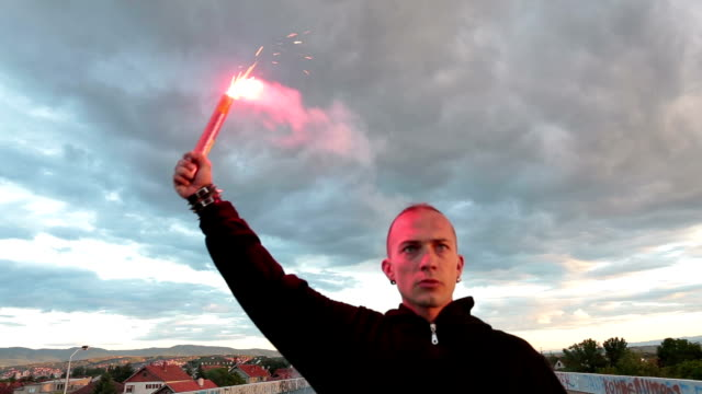 hooligan holding a torch at the bridge - arms raised stock videos & royalty-free footage