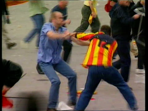 hooligans banned from travelling to greece for the world cup lib charleroi england fan beating up belgian fan pan - hooligan stock videos & royalty-free footage