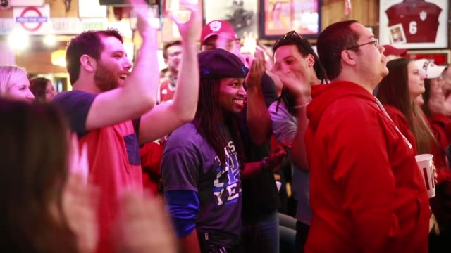 Hoosier fans clap in the face of a University of Kentucky fan watching his basketball team play the IU Hoosiers during the NCAA tournament Saturday...