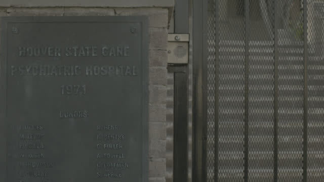 ms 'hoover state care psychiatric hospital 1971' fictitious sign by gate and call box, entrance to insane asylum, mental health institute - mental health professional stock videos & royalty-free footage