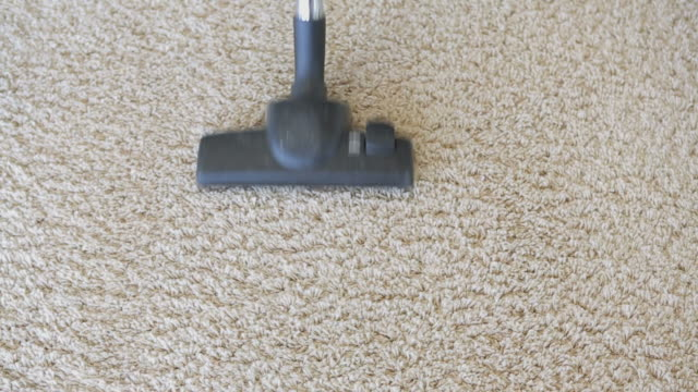 Hoovering the carpet