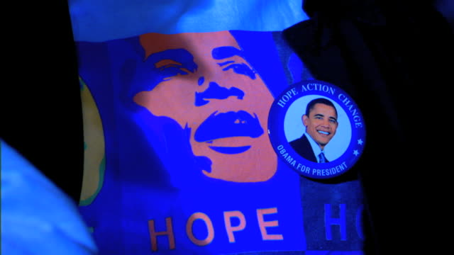 stockvideo's en b-roll-footage met hope action changeobama for president campaign slogan w/ photo pinback button zo ms hope shirt w/ button pan to button on hope shirt - 2008
