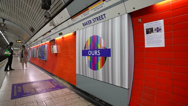 """hope"""" by sarah, analyst at hammersmith london underground station at tfl installs new equality signs across london underground tube network on... - business finance and industry stock videos & royalty-free footage"""