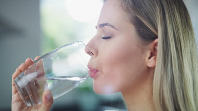 i hope everyone is staying hydrated today - drinking glass stock videos & royalty-free footage