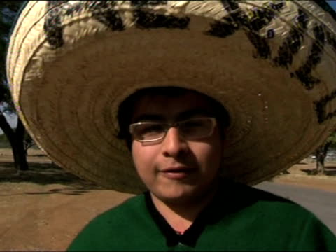hopeful french and mexican football fans celebrate outside peter mokaba stadium in polokwane ahead of their teams' world cup match images and... - campionato sportivo video stock e b–roll