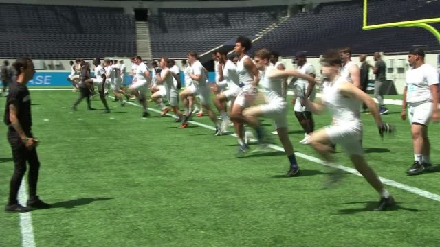 hopefuls try out for new nfl academy in north london; england: london: tottenham: tottenham hotspur stadium: ext general views of academy students... - sports training drill stock videos & royalty-free footage