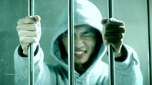 hoping freedom,prisoner catch a steel cage in a cell - material stock videos & royalty-free footage