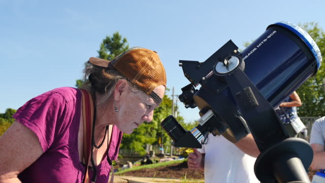 stockvideo's en b-roll-footage met eclipse watchers view a total solar eclipse's transit across the united states during the great american eclipse august 21 2017 at little river park... - de ruimte en astronomie