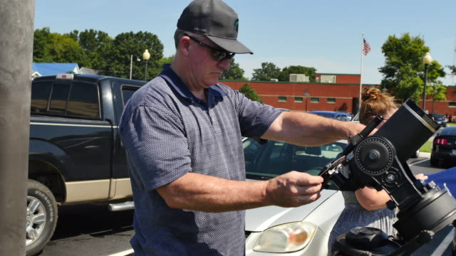 stockvideo's en b-roll-footage met eclipse watchers wait to view total solar eclipse's transit across the united states during the great american eclipse august 21 2017 at little river... - de ruimte en astronomie
