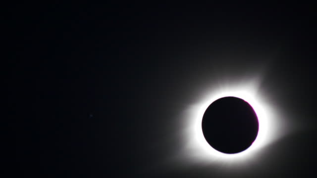 The moon blocks the sun but the sun's corona goes around it during a total solar eclipse's transit across the United States August 21 2017 in...