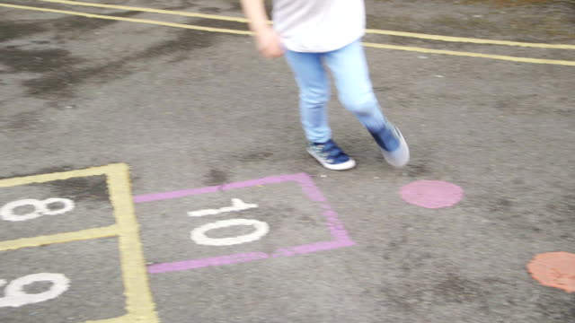 hopscotch is fun - playground stock videos & royalty-free footage