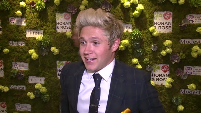 Interviews ENGLAND London INT **Music heard in background** PHOTOGRAPHY** Niall Horan interview SOT Horan and Justin Rose posing for photocall Justin...