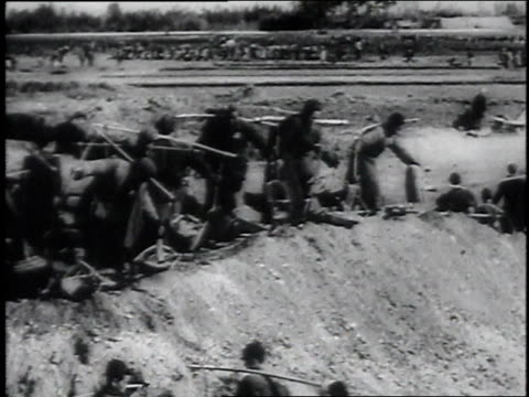 montage hordes of workers moving rocks and dirt with shovels and wheelbarrows / china - 1946 stock videos and b-roll footage