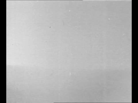 ws horizon atomic bomb detonates with vo flash of light mushroom cloud as part of experiment to determine blast effects on structures people / us... - radioaktiver niederschlag stock-videos und b-roll-filmmaterial