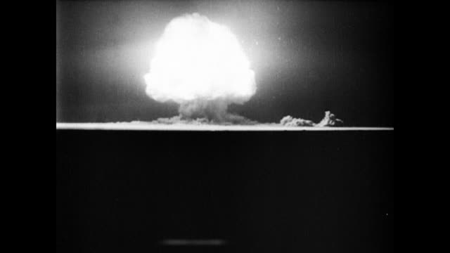 / Horizon view of the first atomic bomb test / several explosive sounds and the formation of a mushroom cloud First atomic bomb is tested at Trinity...