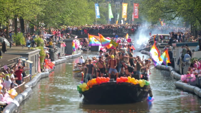 horizontal color footage of people celebrating the annual canal parade of amsterdam pride in 2017 - societal symbol stock videos & royalty-free footage