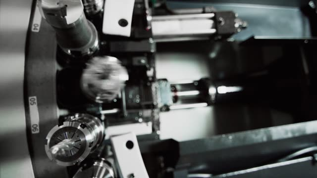 a horizontal machining center changes out a drill bit as other tools rotate in a tool changer machine in a manufacturing facility - drill bit stock videos and b-roll footage