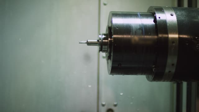 a horizontal machining center changes out a drill bit before cutting out aluminum parts in a manufacturing facility - drill bit stock videos and b-roll footage