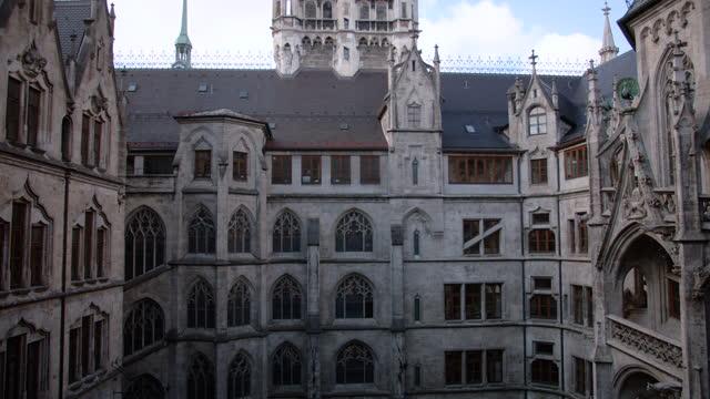 horizontal wide angle view of new townhall inner courtyard facade - ペディメント点の映像素材/bロール
