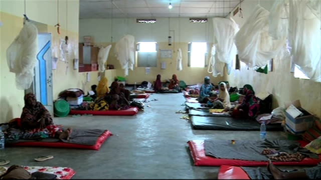 un calls emergency meeting galcayo int drought and famine victims seated on makeshift beds in ward of medecins sans frontieres msf hospital - horn of africa stock videos & royalty-free footage