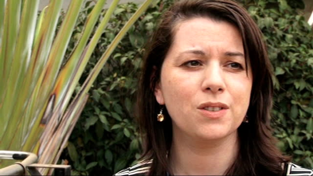 un calls emergency meeting kenya nairobi stephanie savariaud along with reporter and interview sot amanda lindhout set up working at laptop computer... - horn of africa stock videos & royalty-free footage