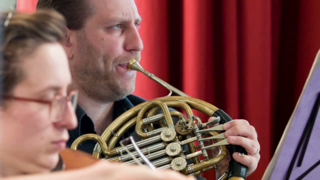 horn player in orchestra - french horn stock videos and b-roll footage