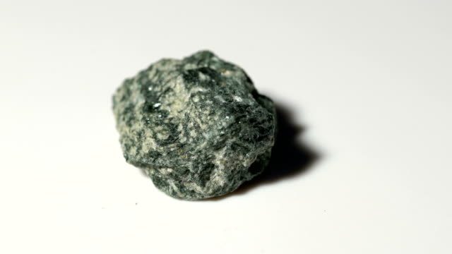 hornblende mineral sample in rotation with white background - schist stock videos and b-roll footage