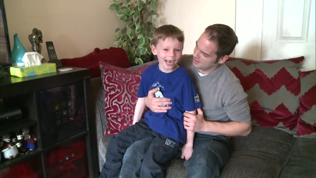 vídeos de stock, filmes e b-roll de hornchurch boy suffering from rare hypothalamic hamartoma brain tumour england london hornchurch int nathan box seated with his father as laughing... - tumor cerebral