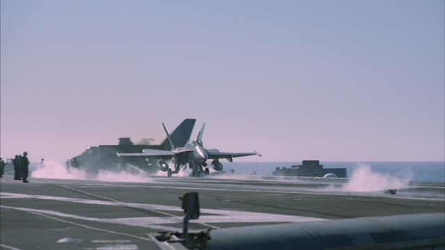 a f18 hornet takes off from an aircraft carrier. - aircraft carrier stock videos & royalty-free footage