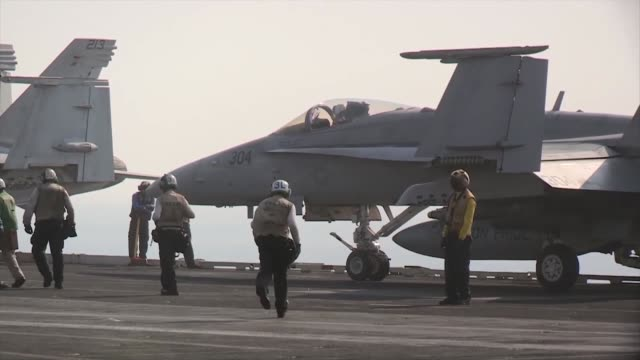 stockvideo's en b-roll-footage met hornets and ea-6b prowlers return to and launch from the aircraft carrier uss george h.w. bush in support of strike, surveillance and reconnaissance... - perzische golf