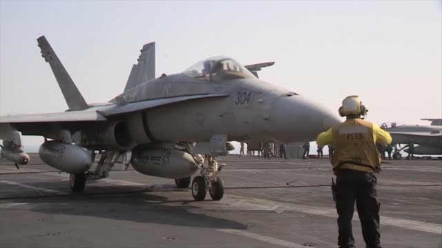 hornets and ea-6b prowlers return to and launch from the aircraft carrier uss george h.w. bush in support of strike, surveillance and reconnaissance... - persian gulf stock videos & royalty-free footage