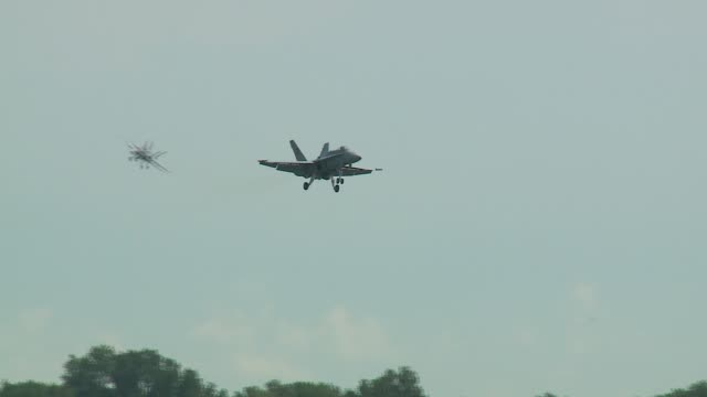 hornets, twin-engine supersonic, carrier-capable multirole combat jets, landing at the gary/chicago international airport before the 2016 chicago air... - chicago air and water show stock videos & royalty-free footage