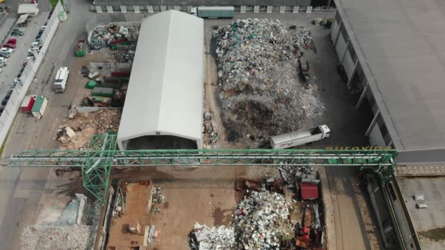 a horrific view of garbage dump from above - garbage disposal stock videos and b-roll footage