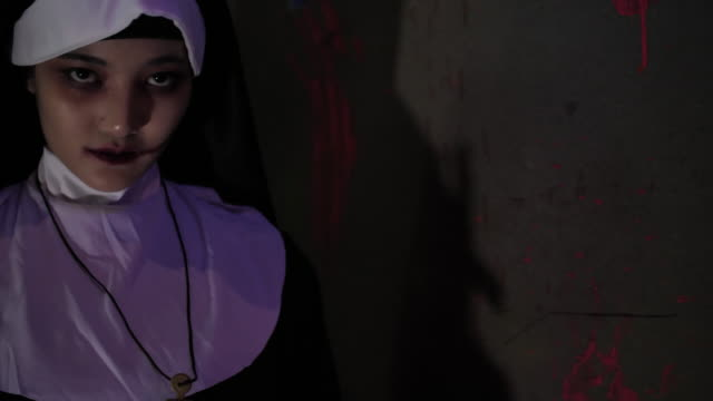 horror nun screaming to camera in halloween event - nun stock videos & royalty-free footage