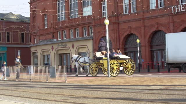 horse and cart pass by the blackpool dungeon on september 29 in manchester, england. - dungeon stock videos & royalty-free footage