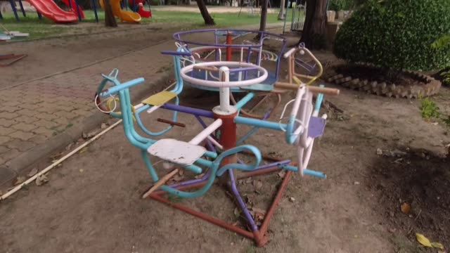 horse carousel spinning in the  kid playground - carousel horse stock videos and b-roll footage