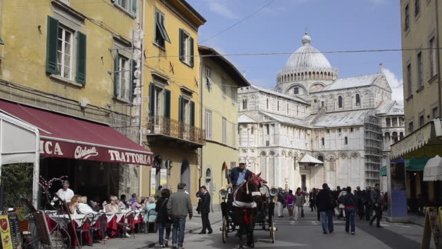 ws horse carriage drives at street restaurant and cathedral santa maria assunta / pisa, tuscany, italy - sicily stock videos & royalty-free footage