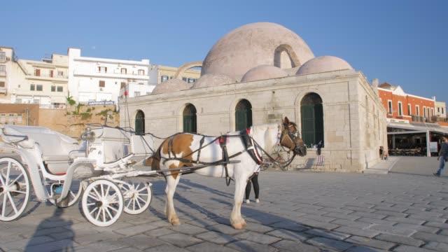stockvideo's en b-roll-footage met horse carriage, mosque, venetian harbour, chania, crete, greece, europe - 17e eeuw