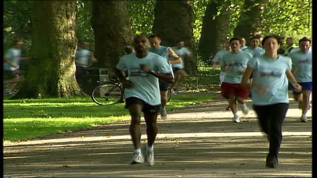 horse chestnut trees in london threatened by tree blight; runners in battersea park supporters by side of race runner away to finish dissolve - battersea park stock videos & royalty-free footage