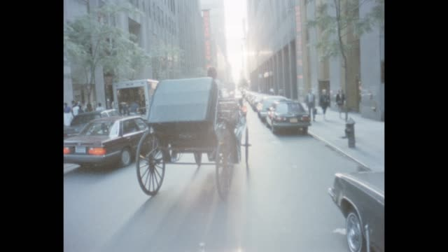 1985 nyc - horse drawn carriage in midtown - radio city music hall stock videos & royalty-free footage