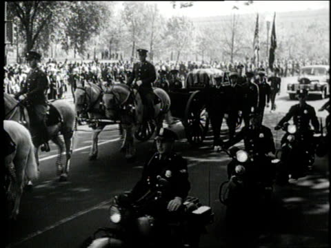 a horse drawn carriage pulls the flag draped casket of united states president franklin d roosevelt - funeral stock videos & royalty-free footage