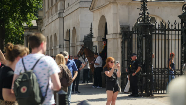 horse guard on duty in london with tourists - british military stock videos & royalty-free footage