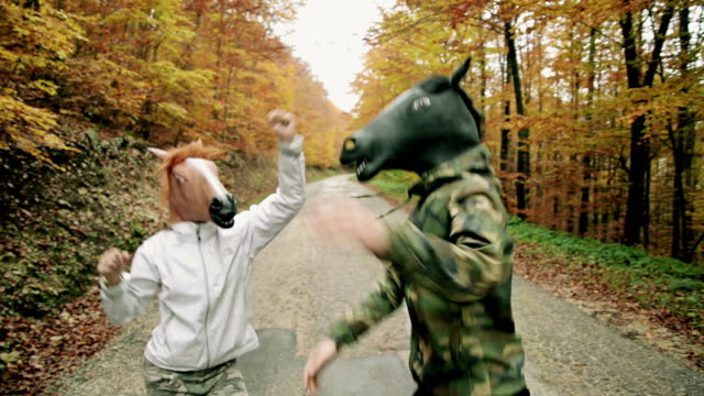horse head mask. - two people stock videos & royalty-free footage