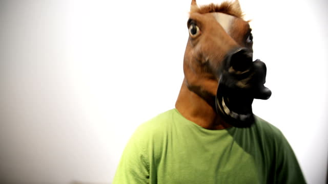horse mask. funny video. - one young man only stock videos & royalty-free footage